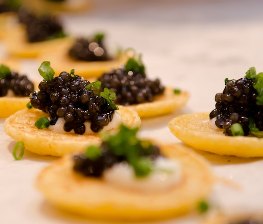 Mote Marine Sturgeon Caviar with Citrus Crème Fraîche and Chives on Johnnycake Blini