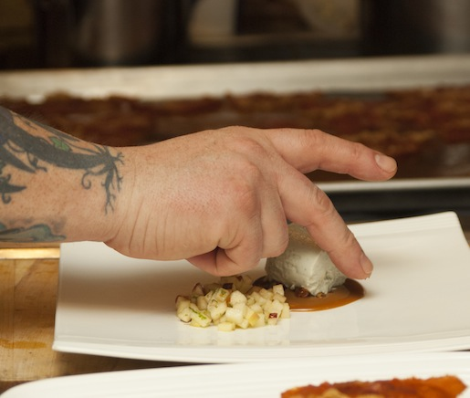 Chef Brian Alberg plating cheesecake in the Beard House kitchen