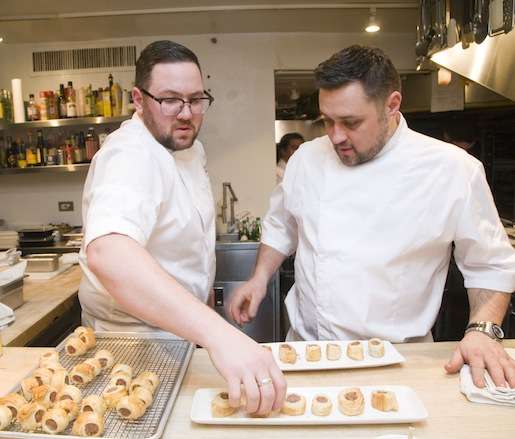 Chefs Ryan Butler and Chris Rendell plating hors d'oeuvres in the Beard House kitchen
