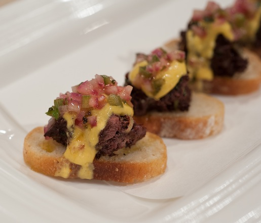 Sangrecita Crostini with Morcilla, Huancaína, and Jalapeño Salsa Criolla