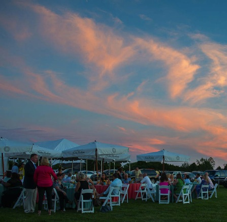 Sunset illuminates the sky over Chefs & Champagne guests