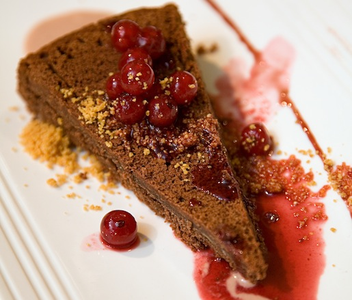 Dark Perugian Chocolate and Hazelnut Cake, Grappa, Balsamic and Merlot Sabayon, Spiced Port Reduction, Currants