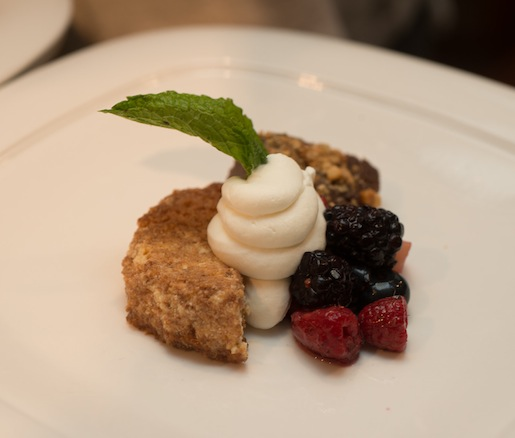 Ricotta, Mascarpone, and Gorgonzola Cheesecake with Chocolate–Hazelnut Polenta, Berry Macedonia, and Vanilla–Amaretto Whipped Cream