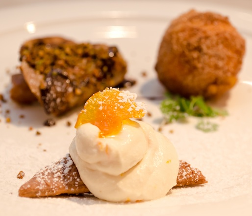 Dessert Sampler > Ricotta Doughnuts with Vanilla–Orange Cream and Cappuccino Crème Anglaise; Sicilian Pistachio Couscous with Candied Cucuzza Squash and Rosemary-Infused Milk Custard; and Chocolate Salami with Toasted Panettone Bread Crumbs and Almond