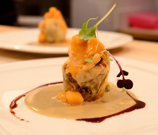 Duck Confit Strudel with Housemade Mascarpone, Foie Gras Cream, Roasted Peach Compote, and Vincotto