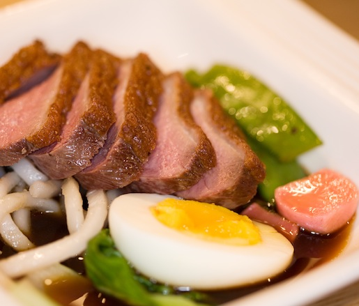 Long Island Duck with Udon Noodles, Baby Bok Choy, Pickled Radishes, Burnt Scallions, and Chai-Spiced Coconut Broth