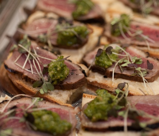 Cane Syrup–Cured Duck, Fig Mascarpone, and Green Onion Pesto Crostini