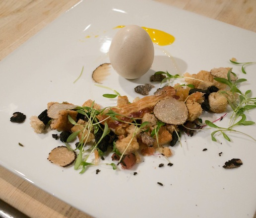 The Incredible Edible Egg > Marbled Rye–Pine Nut Picada with Warm Egg Yolk, Cauliflower Soubise, Crispy Pancetta Chip, and Wildflowers