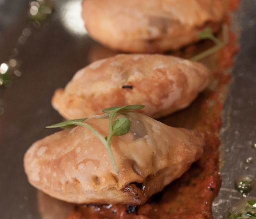Empanadas Del Campo with Wagyu Rib-Eye, Caramelized Onions, and Romesco