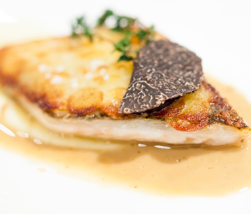 Sea Bass with Crispy Potatoes, Truffle Jus, and Black Truffles