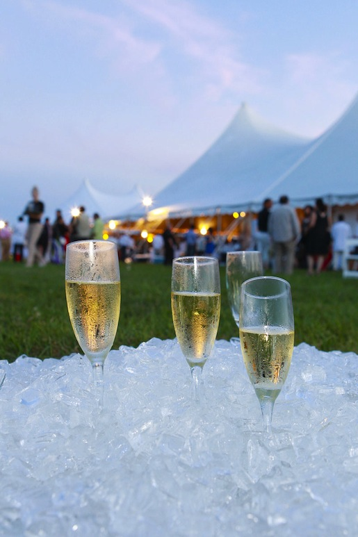 Champagne flutes chilling on ice