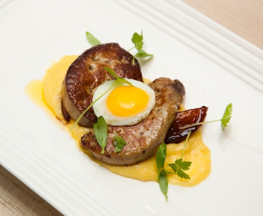 Seared Quebec Foie Gras with Creamy Corn Purée, Wine-Poached Peaches, and Quail Egg