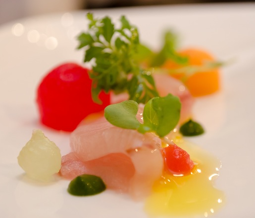 Hiramasa Tiradito with Castelvetrano Olives, Compressed Watermelon, Blood Orange Oil, and Micro-Basil