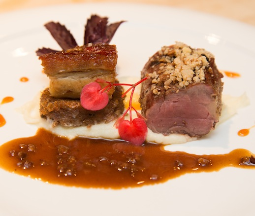 Black Iberian Pig > Roasted White Acorn–Crusted Tenderloin, Pine Cone–Lacquered Belly, and Cheek Cheese with Red Oak–Smoked Trotter Jus