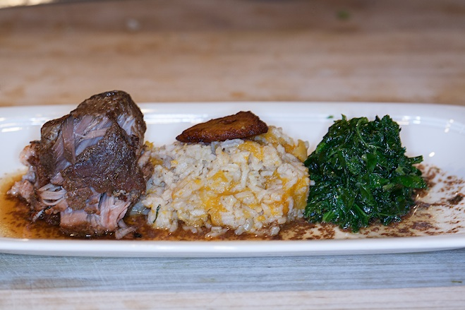 Ric's Classic Jerk Pork > Wood-Grilled and Pulled Pork Shoulder with Allspice, Thyme, Hot Peppers, Scallions, Davenport's Pumpkin Rice, Callaloo, and Plantain Crisp