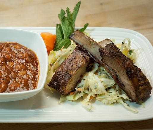 Denver Lamb Ribs with Hickory Pit Beans and Cilantro–Mint Slaw