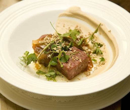 Roasted Lamb with Crispy Lamb's Tongue, Pickled Almond Purée, Tarragon Jus, White Anchovy Butter, and Tomato Conserva
