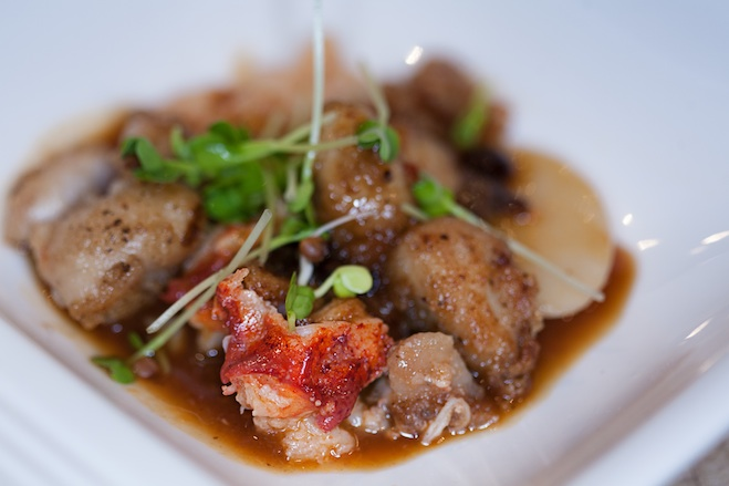 Glazed Long Island Lobster and Quebec Sweetbread Nuggets with Textured Rice Cakes, Fermented Black Beans, Umeboshi Plum–Roasted Ginger Reduction, and Daikon Sprouts