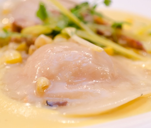 Caribbean Lobster Ravioli with Creamed Corn Velouté, Sautéed Chanterelles, and Micro-Green Salad