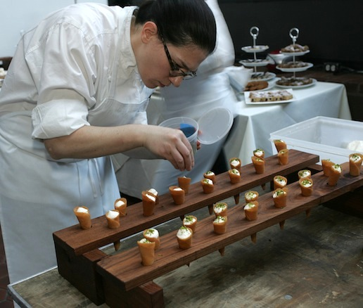 Chef Karen Weiner plating Yogurt Mousse in the Beard House kitchen