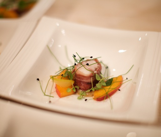 Coppa–Wrapped Monkfish with Grilled Peaches, Toasted Almonds, and Basil Broth