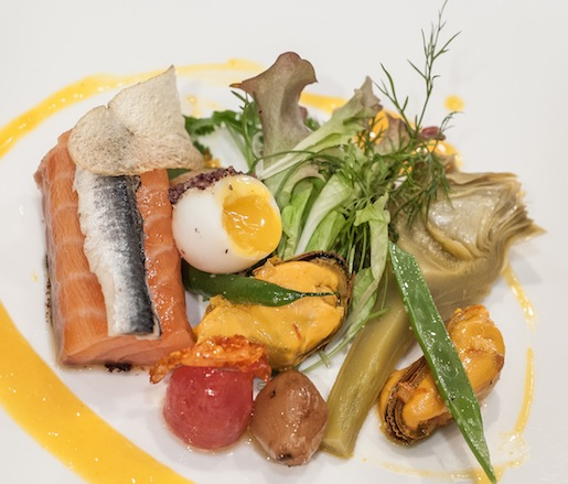 Warm Salmon Niçoise with Olive-Crusted Quail Egg, Artichokes, and Pickled Mussels