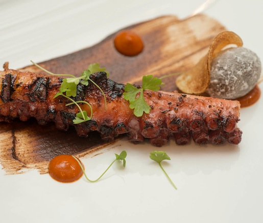 Spanish Octopus a la Plancha with Salted Potatoes, Fermented Black Garlic, and Romesco