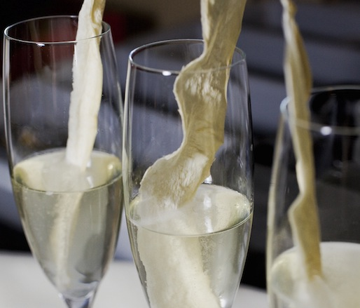 Oy Vey > Champagne with Horseradish-Infused Sugar Cube, Bitters, and   Lemon Peel