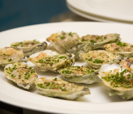 Blue Point Oysters Gratinée with Mascarpone, Prosciutto di Parma, and Scallions