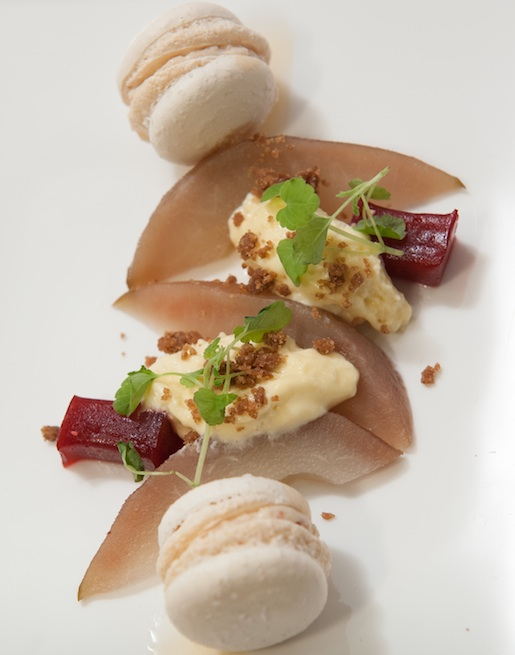 Pears with Honey–Vanilla Crémeux, Raspberry Gelée, French Toast Crumble, and Bacon Macaron