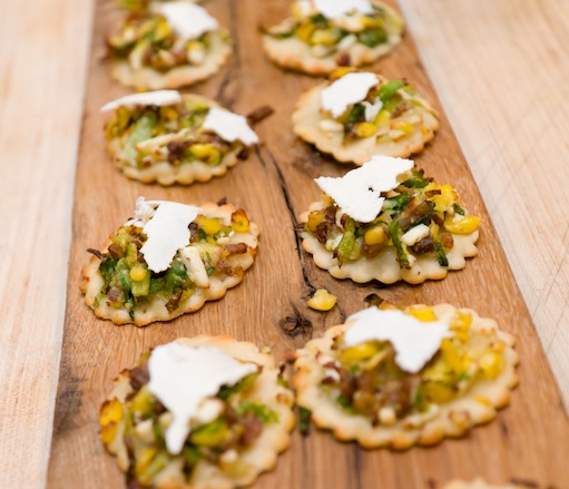 Miniature Pizzas with Lamb Bacon, Corn, Brussels Sprouts, and Ricotta Salata