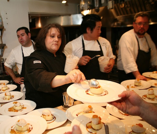 Chef Gina DePalma plating dessert in the Beard House kitchen