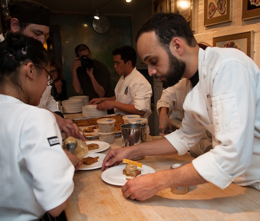 Chef Sean Callahan plating dessert in the Beard House kitchen