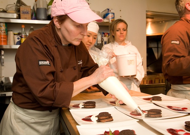 Chef Alisa Huntsman plating dessert in the Beard House kitchen