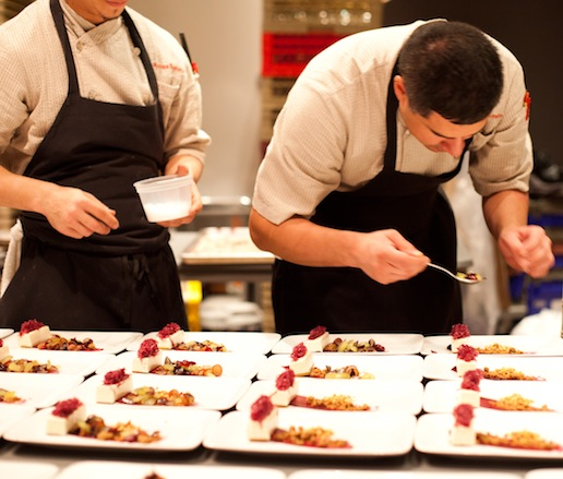 Behind the scenes in the kitchen as chefs plate the dessert course