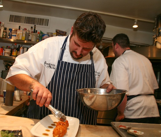 Chef Daniel Doyle plating fritters in the Beard House kitchen