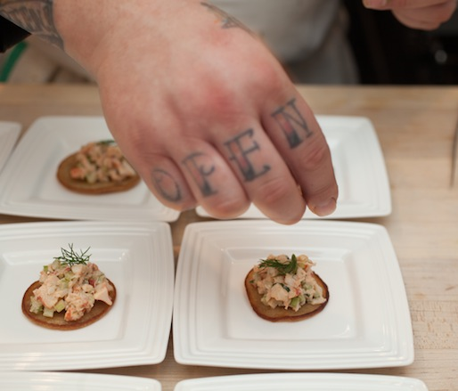 Chef Eric Cooper plating Johnny Cakes