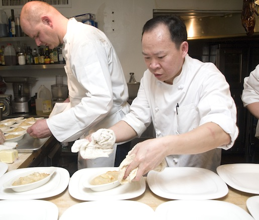 Chefs Peter Chang and Scott Drewno plating sea bass in the Beard House kitchen
