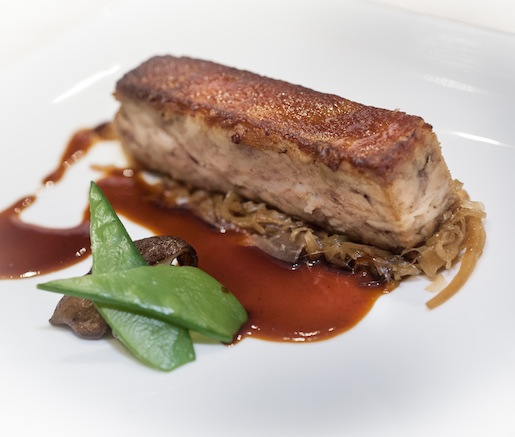 Milk-Fed Pork Confit with Shiitakes, Sour Cabbage, and Honey–Ginger Glaze