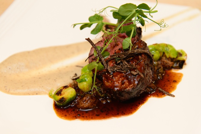 Espresso-Scented Rack of Venison with Venison Shoulder Ragù, Lentilles du Puy, Baby Brussels Sprouts, and Black Truffle Jus