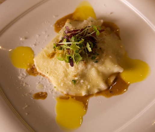 Game Bird Ravioli with Game Bird Jus, Chestnut Crumble, Egg Yolk Sauce, and Petite Herb Salad