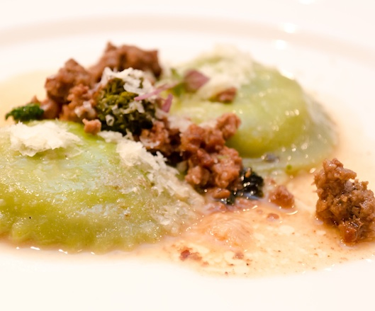 Sicilian Oregano–Infused Ricotta and Broccoli Rabe Ravioli with Spicy Lamb Sausage and Dried Cherries