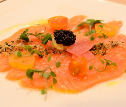 Skuna Bay Craft-Raised Salmon​ Crudo with Pine Nut Gremolata, Pickled Breakfast Radishes, Heirloom Tomatoes, and Osetra Caviar
