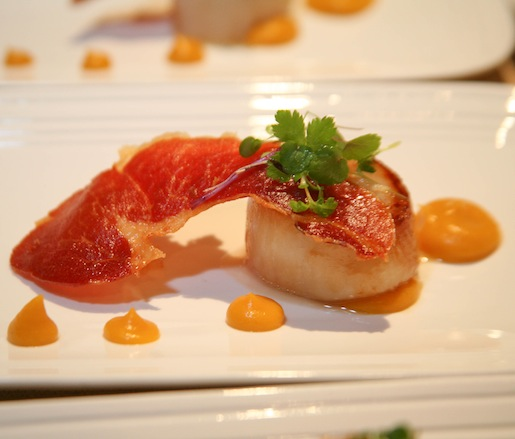 Pan-Seared Scallops with Trotter Rillette and Bourbon–Sweet Potato Vinaigrette