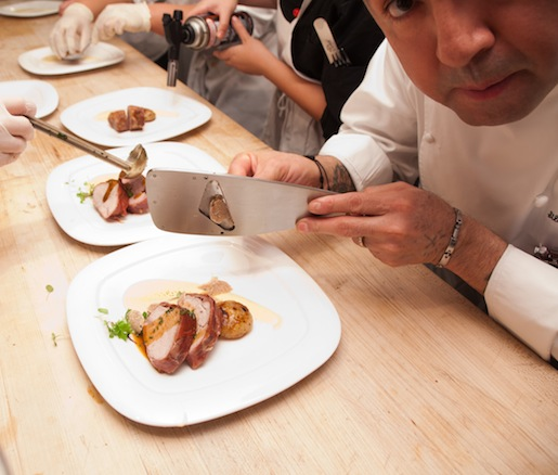 Chef Silverio Chavez plating Veal Tenderloin Medallions