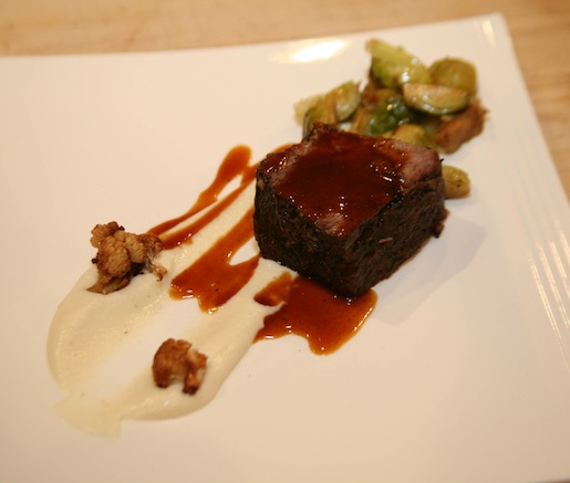Bourbon-Braised Short Ribs with Duck Fat–Fried Brussels Sprouts, Roasted Cauliflower Purée, and Natural Jus