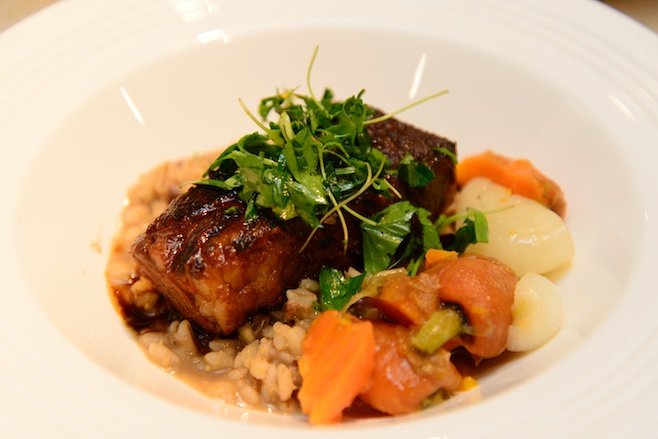 Beer-Braised Short Ribs with Glazed Root Vegetables, Barley Risotto, Dogfish Head World Wide Stout Demi-Glace, and Orange Gremolata