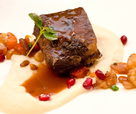 Nero d'Avola–Braised and Cocoa-Rubbed Beef Short Ribs with Pumpkin Purée, Salsify–Black Garlic Purée, and Cauliflower Caponata
