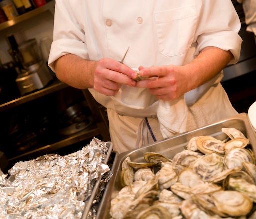 Shucking oysters in the Beard House kitchen