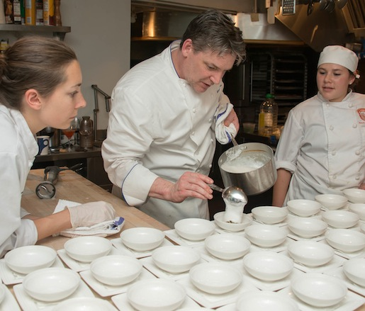 Michael Stanton plates his scallop dish in the James Beard House kitchen